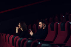 Young caucasian couple sitting in empty theater Stock Photos