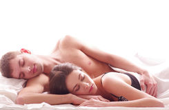 A young Caucasian couple sleeping in the bed Stock Photography