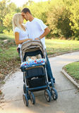 Young Caucasian Couple Taking Their Baby On Walk stock photography