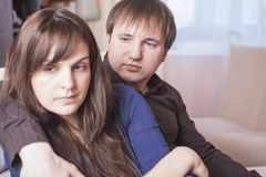 Young Caucasian Couple Trying to solve Relationships Problems. Stock Photo