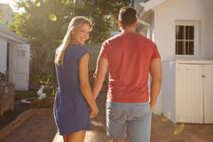 Young caucasian couple walking in the backyard Royalty Free Stock Photo