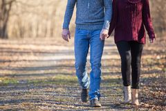 Attractive couple walking holing hands stock images