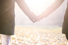 Young caucasian couple walking together outdoor with connected p Royalty Free Stock Images