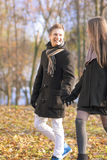 Young caucasian couple walking together outdoor enjoying Royalty Free Stock Image