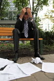 Young caucasian depressed businessman in park Stock Photos