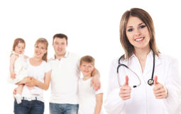 A young Caucasian family and a happy female doctor royalty free stock images