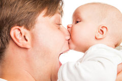 Young Caucasian father playing with baby son Stock Photos