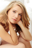 Young caucasian female on bed. Royalty Free Stock Photos