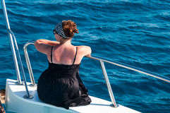 Woman on bow of yacht in Mediterranean sea cruise Royalty Free Stock Image