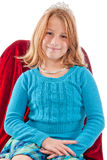 Young caucasian female child princess. Young caucasian female child dressed as a princess sitting on a red velvet chair, wearing a tiara and a dimaond necklace Stock Images
