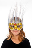 Young Caucasian Female Child Wearing a Mask. A young Caucasian female child wearing a fancy masquerade mask Royalty Free Stock Photography
