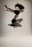 A young Caucasian female dancer in a jump Royalty Free Stock Photo