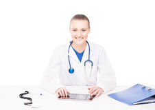 Young Caucasian female doctor working in an office Stock Photography