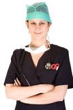 Young Caucasian female healthcare professional. Young adult Caucasian female health-care professional with stethoscope, mask and cap Royalty Free Stock Image
