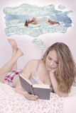 Young Caucasian female reading and imagining Stock Image
