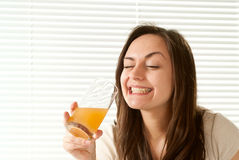 Young Caucasian female sitting in bed with juice Stock Photo
