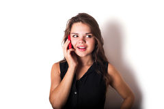 Young caucasian female speaking on phone Stock Images