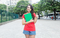 Young caucasian female student with red shirt in the city Stock Image
