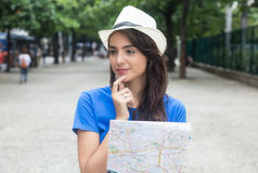 Young caucasian female tourist with map looking around Royalty Free Stock Photo
