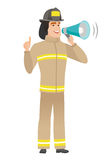Young caucasian firefighter making announcement. Caucasian firefighter with megaphone making an announcement. Firefighter making an announcement through a Royalty Free Stock Photography