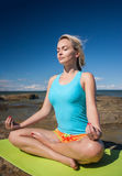 Young caucasian fitness woman practicing yoga Stock Images
