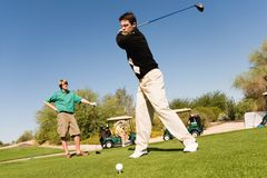 Young Caucasian Friends Playing Golf royalty free stock photography