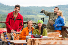Friends hikers relax rest place mountain view Stock Photo