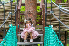 Young caucasian girl in adventure park Stock Images