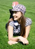 Young caucasian girl on the grass Stock Images