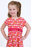 Young caucasian girl in a heart dress. A young caucasian girl in a heart dress with her hands on her hips Stock Photography