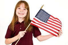 Young girl holding an American Flag. A young caucasian girl holding an American Flag Stock Photography