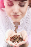 Young Caucasian Girl Holding Heap of Unbroken Coffee Beans and B Royalty Free Stock Image