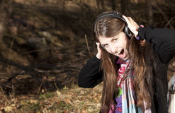 Young caucasian girl listening to music. With headphones looking at camera stock images