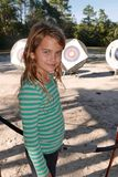 Girl playing archery smiles at the camera stock image