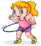 A young Caucasian girl playing with a hulahoop Stock Photo