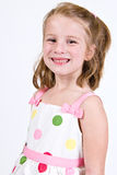 Young Caucasian girl in a polka dot dress.  Stock Images