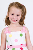 Young Caucasian girl in a polka dot dress Royalty Free Stock Photos