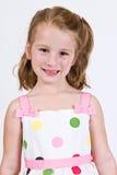 Young Caucasian girl in a polka dot dress.  Royalty Free Stock Photos