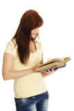 Young caucasian girl reading a book. Stock Images