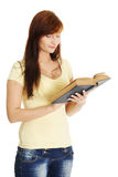 Young caucasian girl reading a book. Stock Photo
