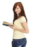 Young caucasian girl reading a book. Royalty Free Stock Photography