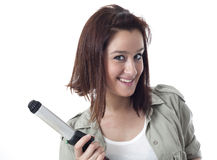Young caucasian girl showing curling iron. Isolated on white Royalty Free Stock Photo