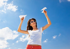 Young caucasian girl with two paper planes Stock Photos