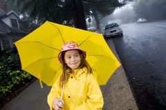 Young caucasian girl with yellow umbrella Royalty Free Stock Photo