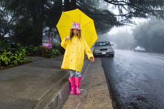 Young caucasian girl with yellow umbrella Royalty Free Stock Photography