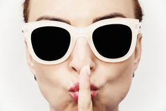 Young caucasian glamour woman with stylish sunglasses and finger royalty free stock photography