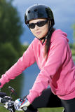 Young caucasian grl in helmet riding bike outdoor Royalty Free Stock Photo