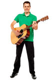 Young caucasian guitarist playing tracks Stock Photos