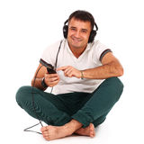 Young caucasian handsome man listening music Royalty Free Stock Images