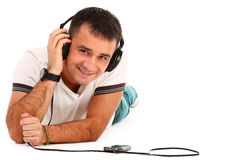 Young caucasian handsome man listening music Stock Image